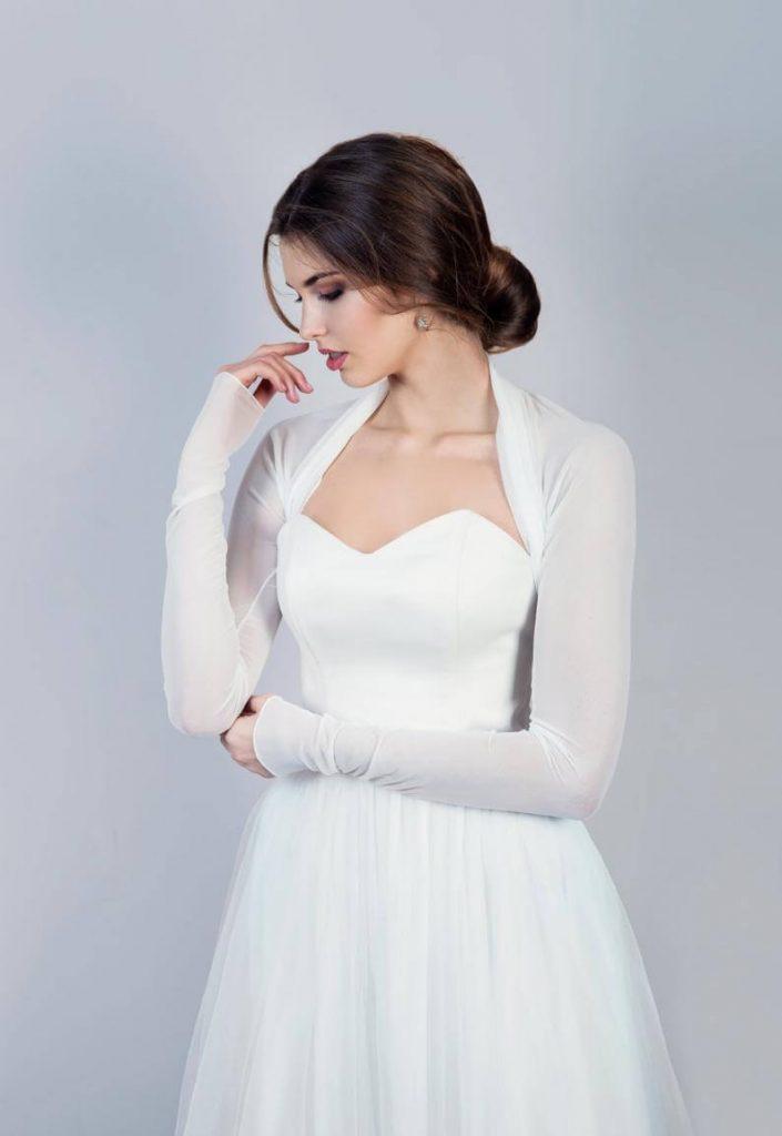 Bride wearing bolero wedding dress