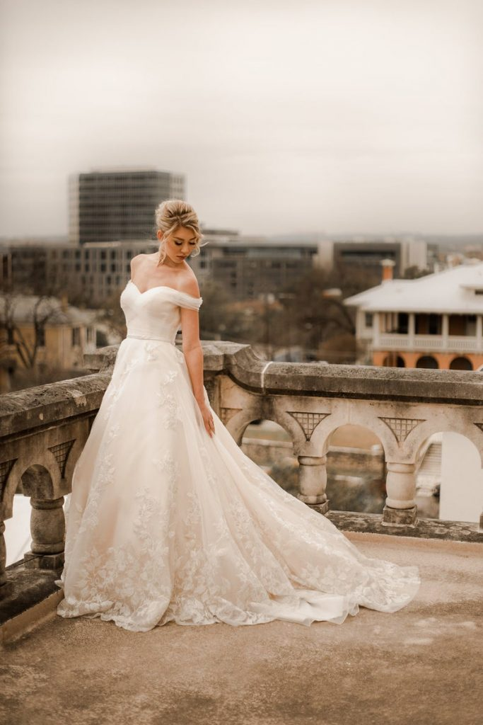 Bride wearing bridal gown with floral design