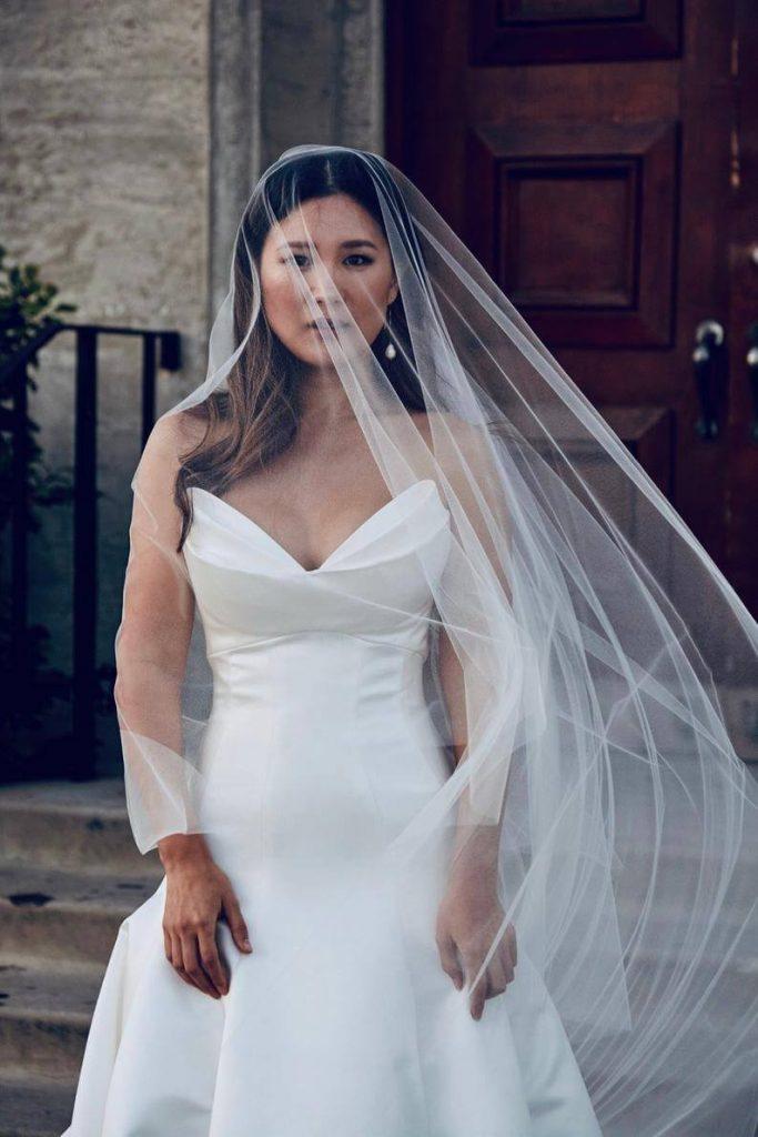 Bride wearing bridal illusion veil