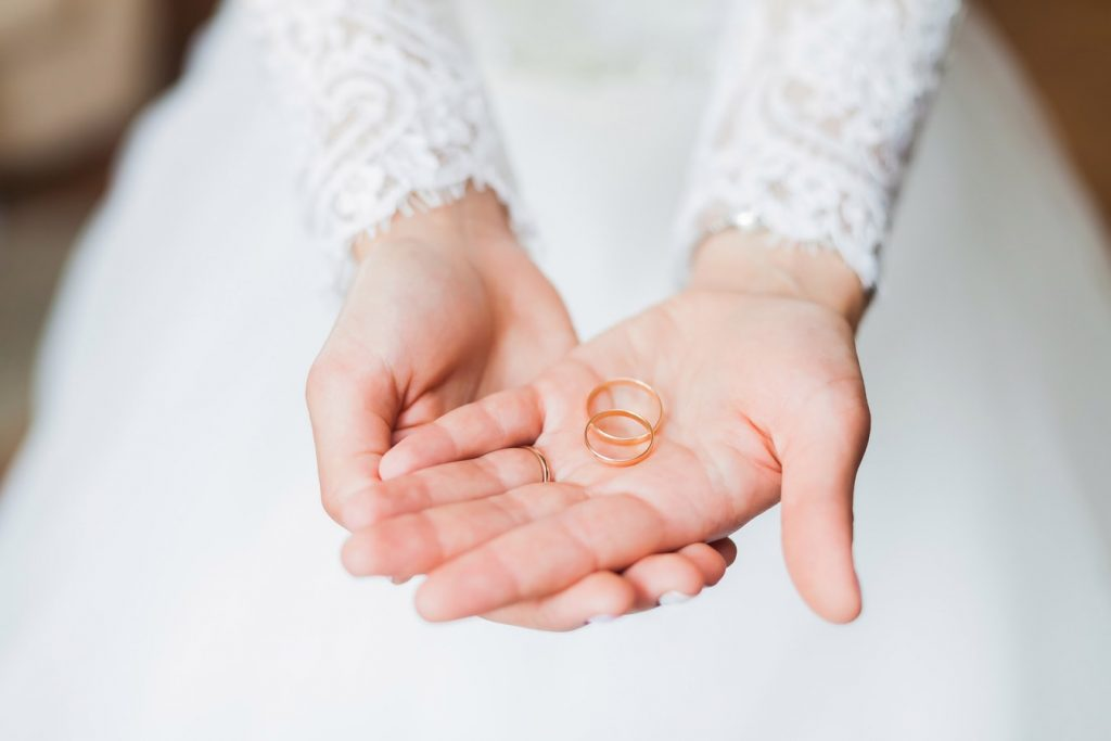 Bronze rings in bride's hand