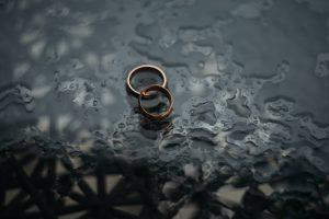 Bronze wedding rings on black background