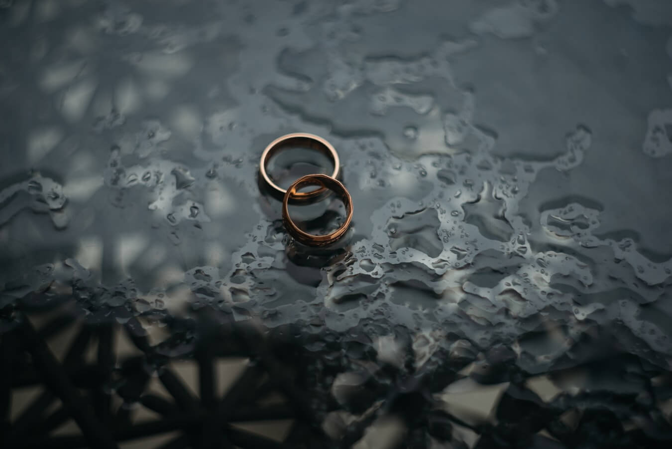 Bronze wedding rings on black background