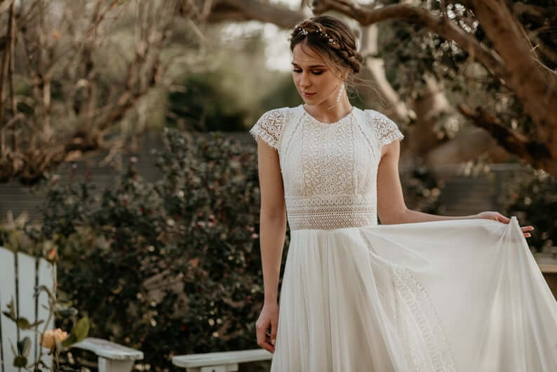 Bride wearing cap sleeves wedding dress