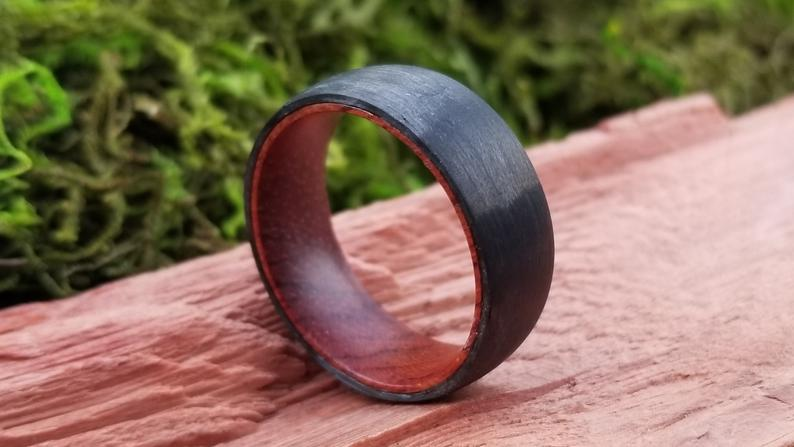 Black carbon fiber ring