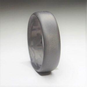 Carbon fiber wedding ring close up