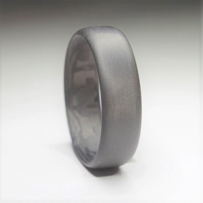 Carbon fiber wedding ring close up