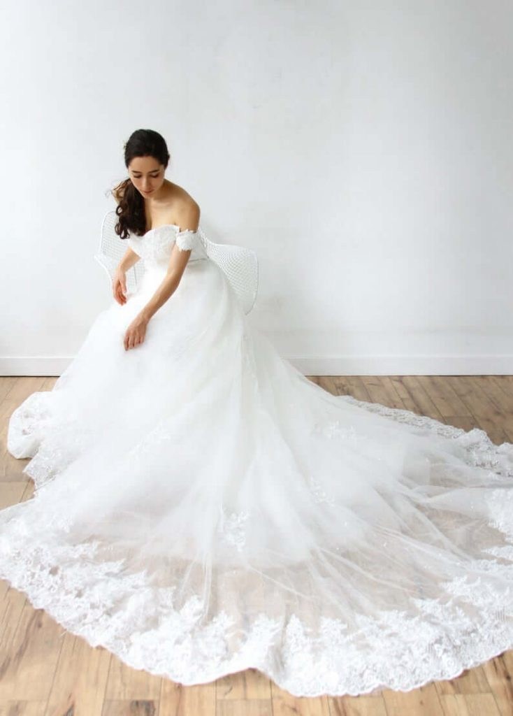 Bride wearing cathedral train wedding gown