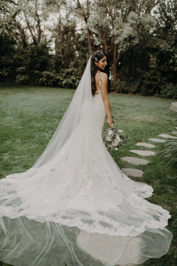 Bride wearing cathedral veil