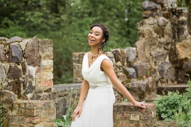 Bride wearing cowl-neckline wedding dress