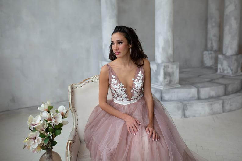 Bride wearing deep v neckline wedding dress