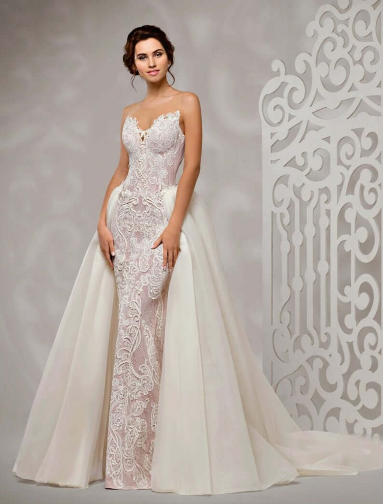 Bride wearing detachable train wedding dress