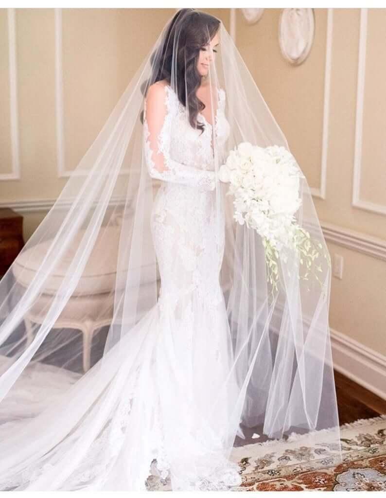 Bride wearing drop veil
