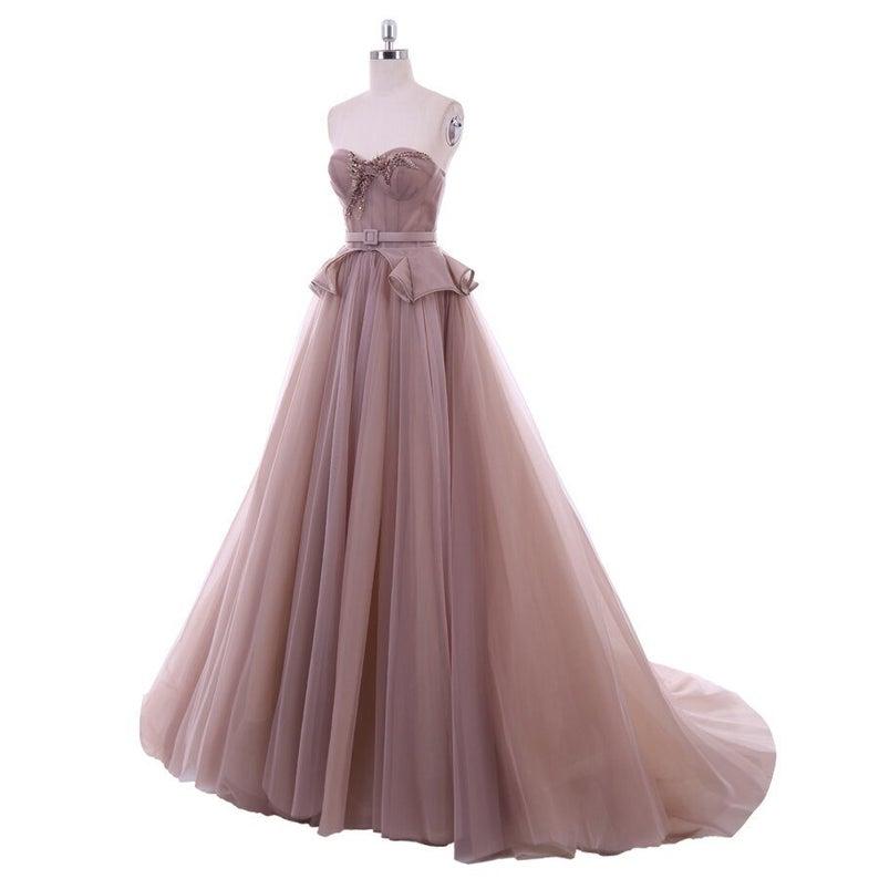 Bride wearing dusky pink wedding dress