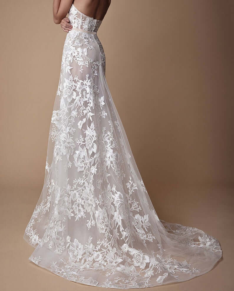 Bride wearing embroidery lace