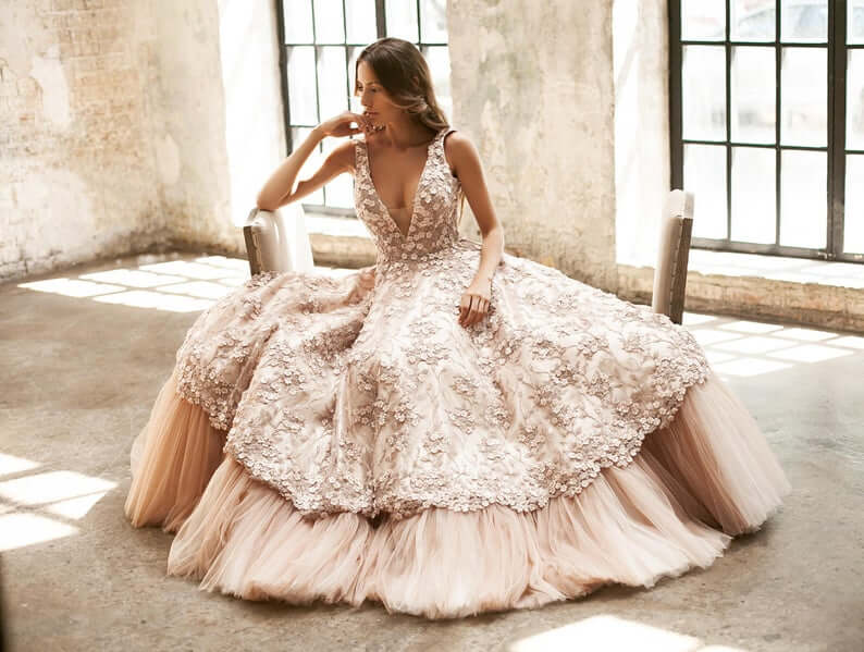 Bride wearing floral applique wedding gown