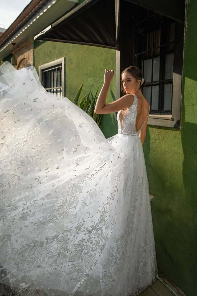 Bride wearing floral lace wedding gown