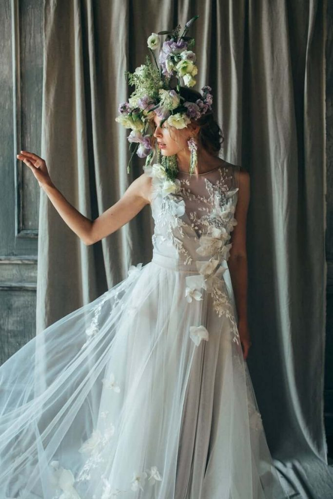 Girl wearing floral wedding gown with lace