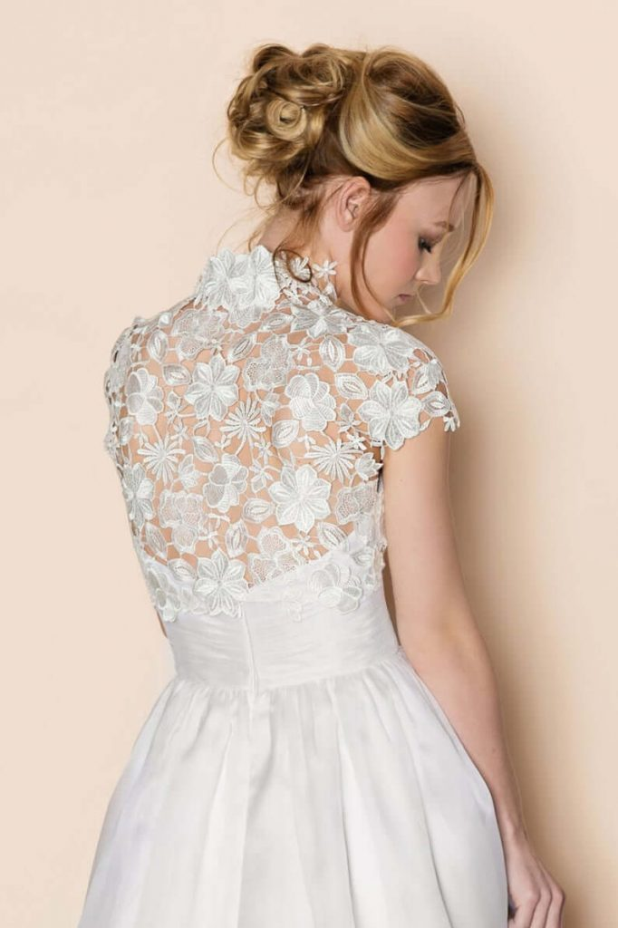 Bride wearing guipure lace bolero