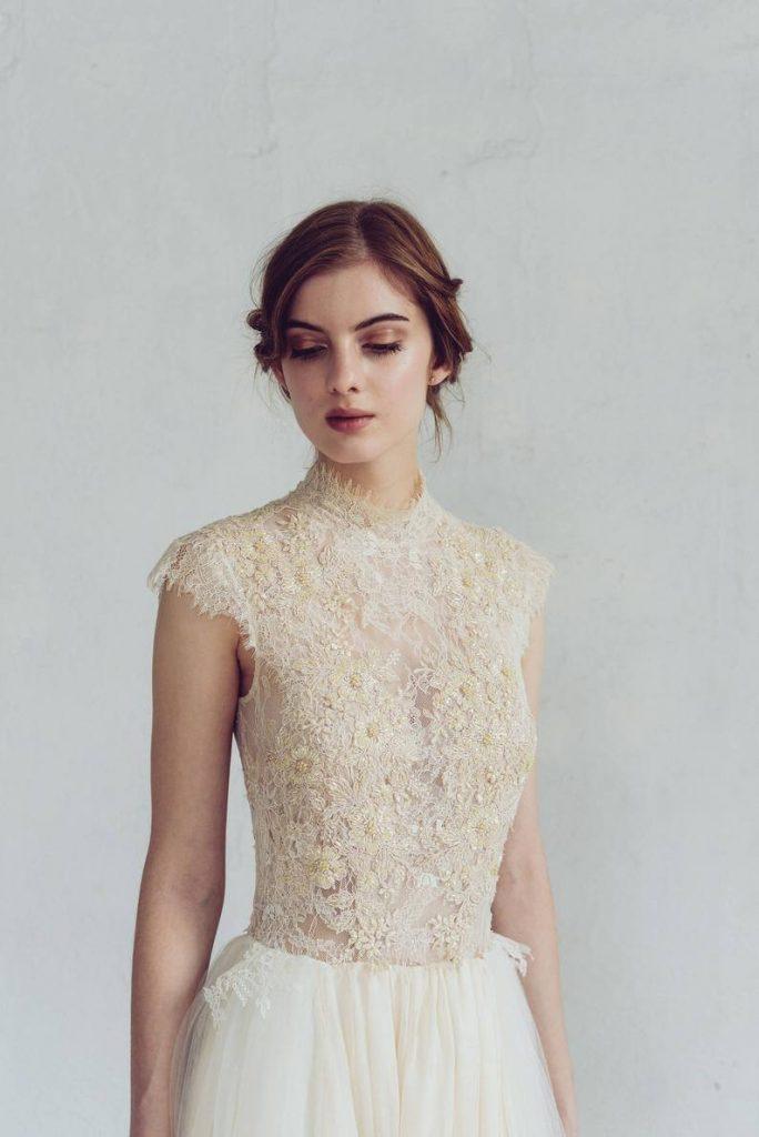 Bride in high neck wedding gown