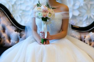 Bride holding flowers in her wedding dress she purchased online