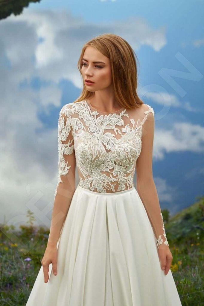 Bride in illusion neckline dress