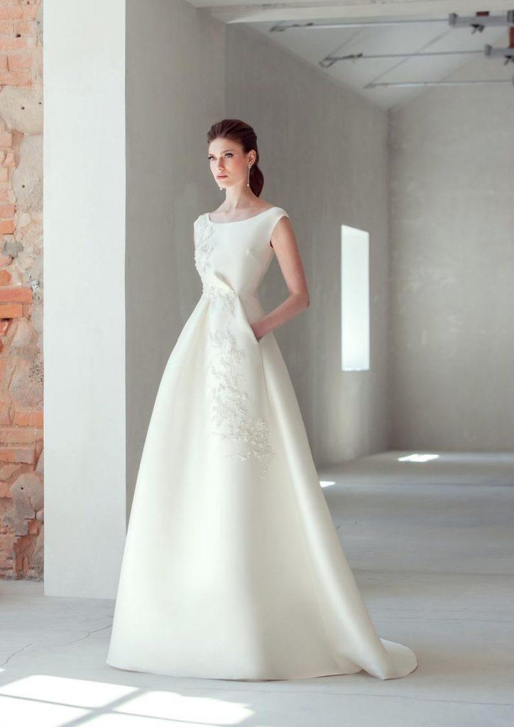 Ivory wedding dress: bride wearing