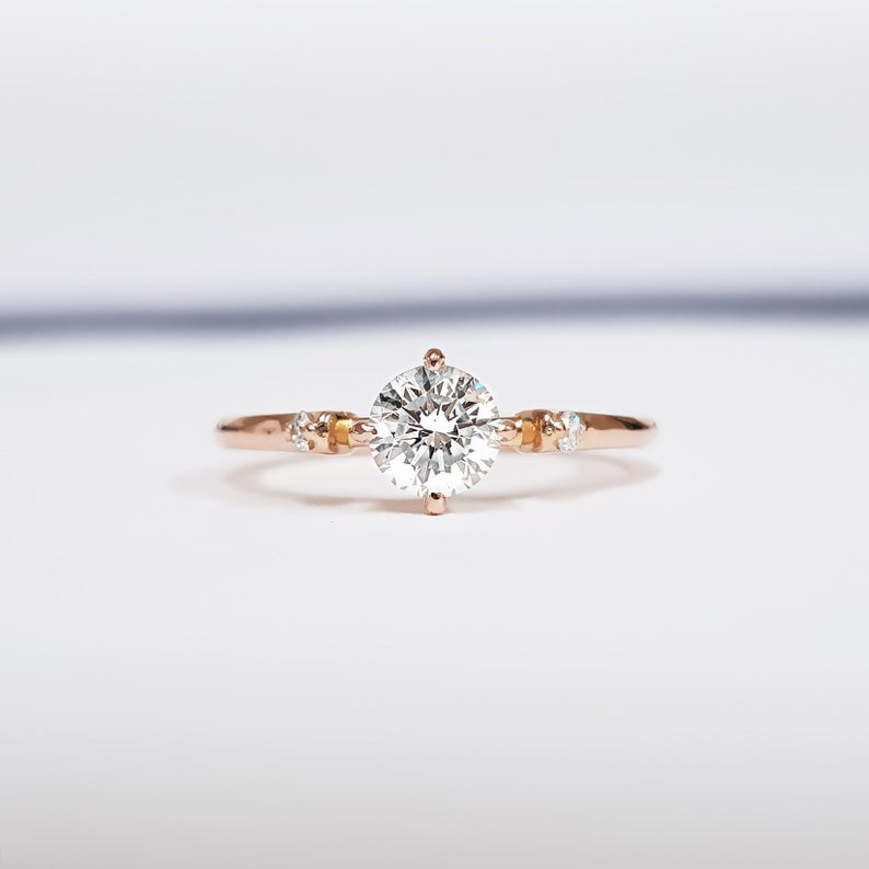 Round shape lab-created engagement ring in rose gold setting