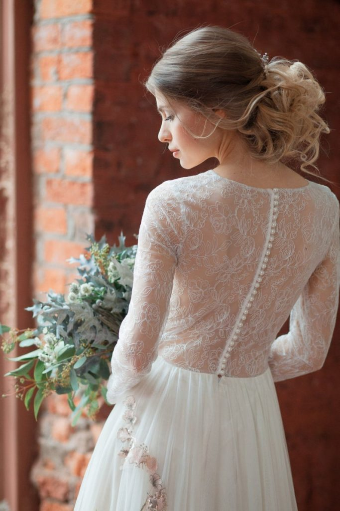 Bride wearing lace wedding dress