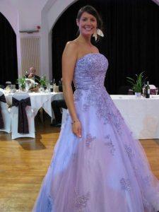 Bride wearing lavender wedding dress