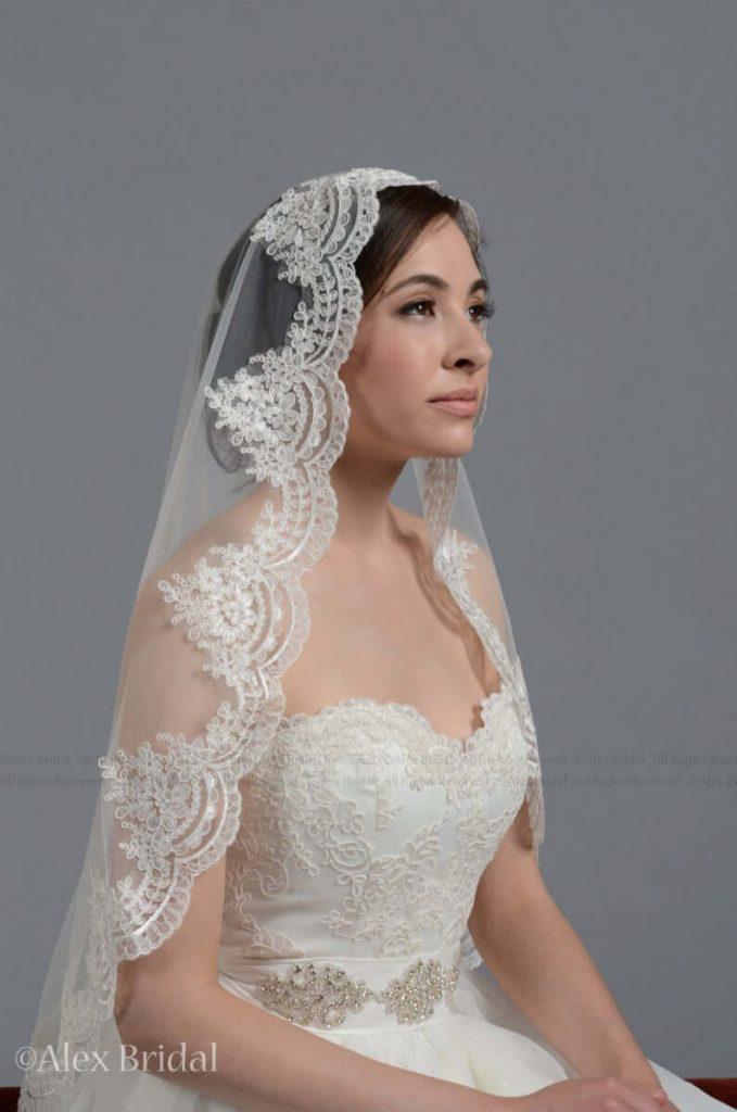 mantilla veil bride wearing