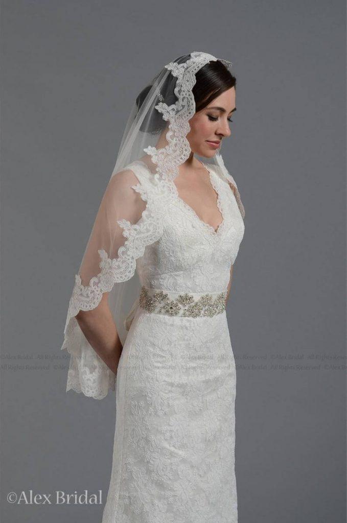 Bride wearing mantilla veil