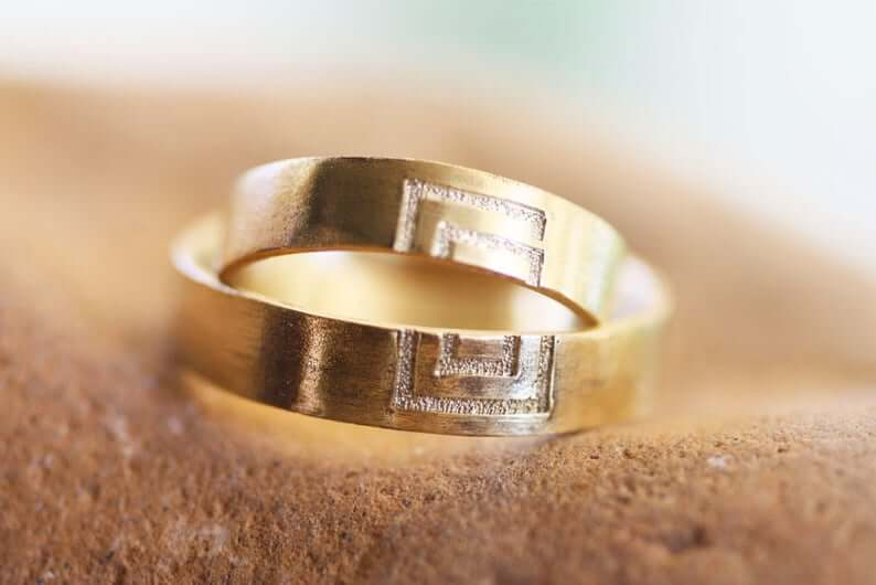 Meander sign couples wedding band