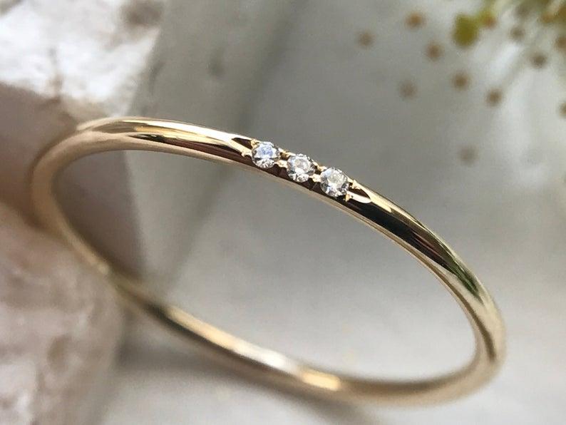 Minimalist three stone ring
