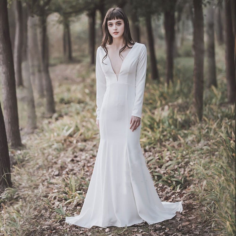 Bride wearing minimalist trumpet wedding dress
