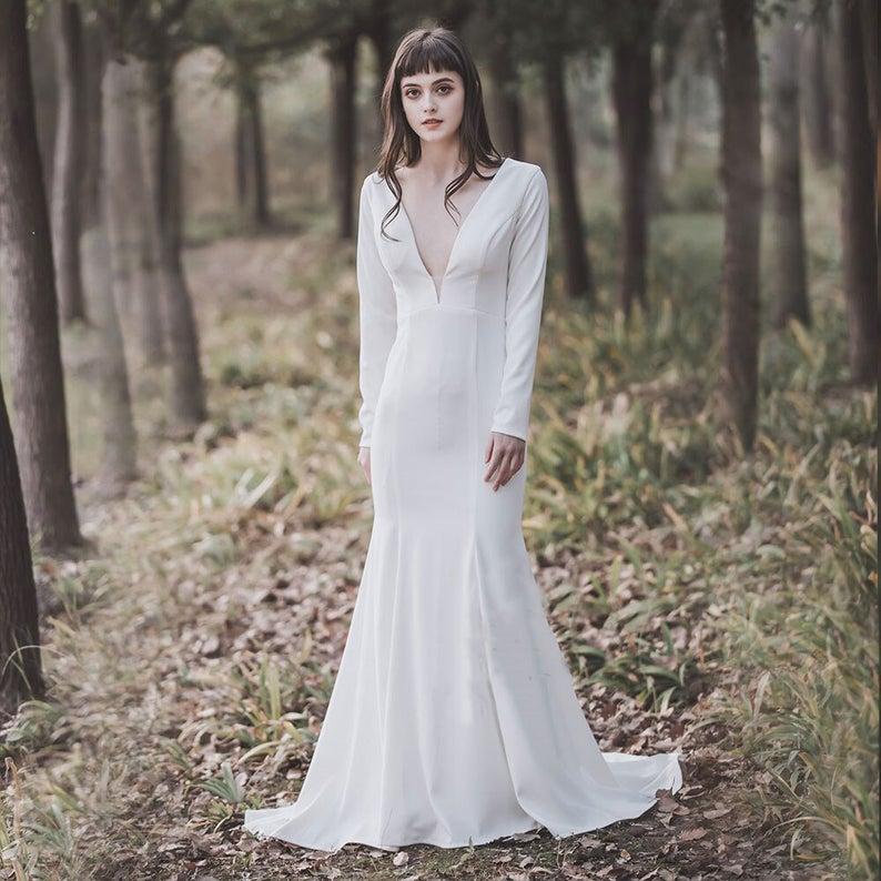 Bride wearing minimalist trumpet wedding dress