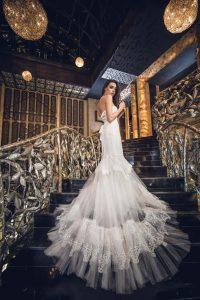 Bride wearing monarch train wedding gown