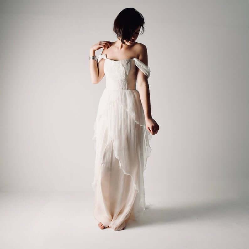 Bride wearing white off-shoulder bohemian dress