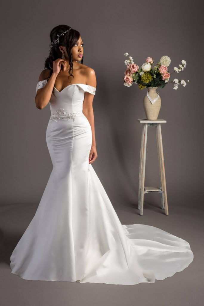 Bride wearing white off shoulder trumpet dress