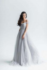Bride wearing off-shoulder wedding dress