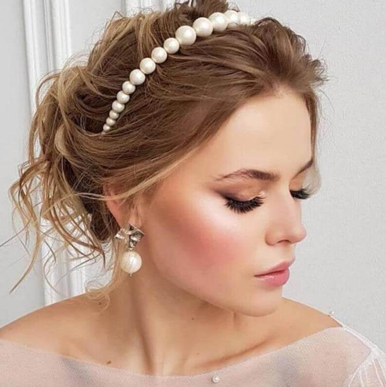 Bride wearing pearl headband