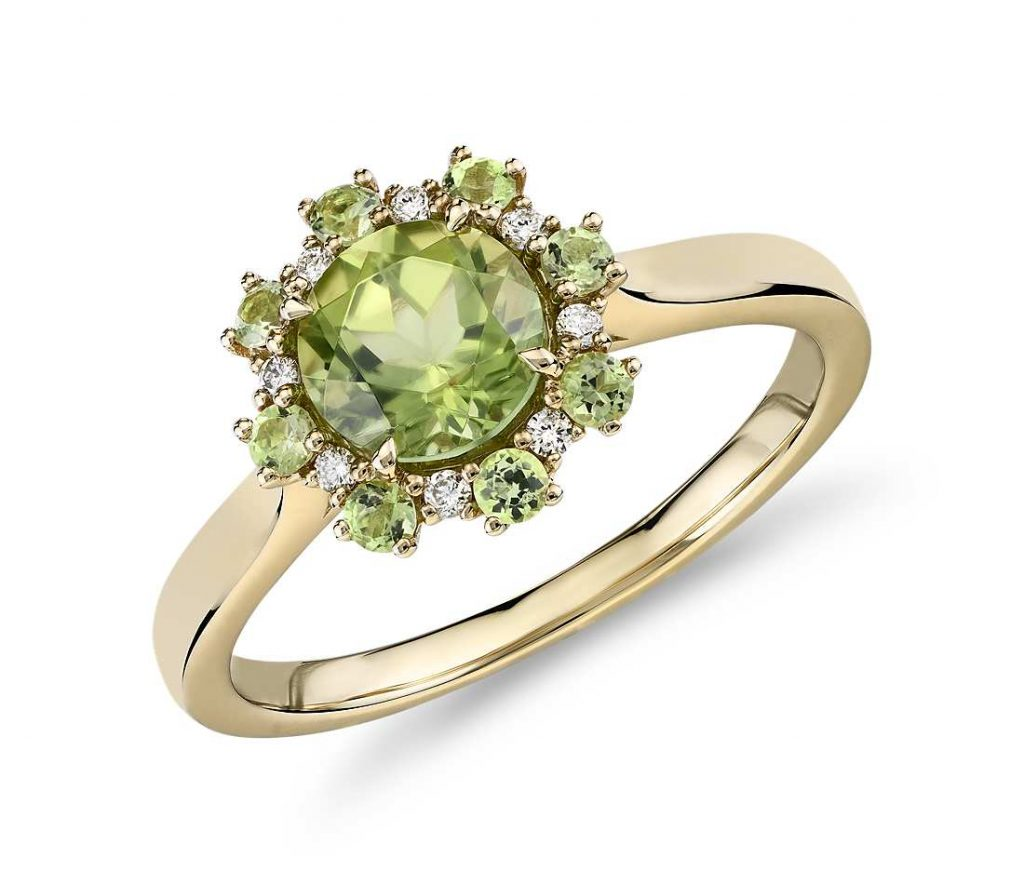 Green peridot yellow gold ring
