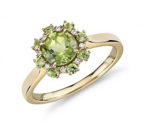 Green peridot yellow gold ring