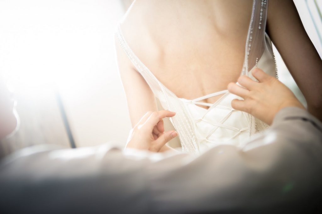 Bride trying on her wedding dress