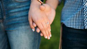 Girl wearing princess cut diamond engagement ring