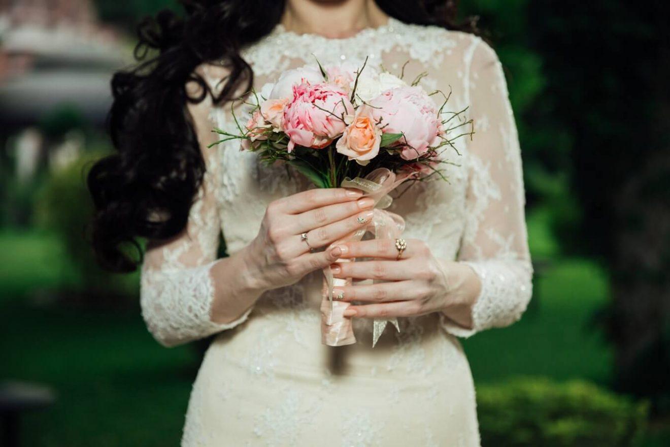 Bride in long sleeve wedding dress