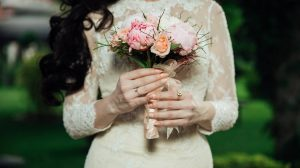 Bride in long sleeve wedding dress