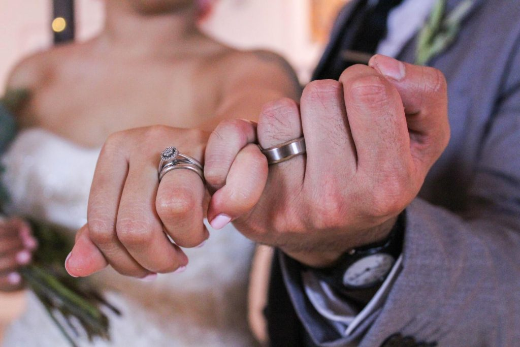 Couple wearing tantalum wedding rings