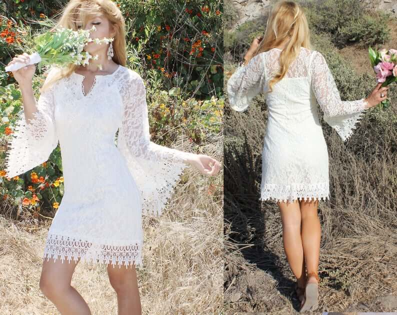Short white boho dress worn by bride dancing