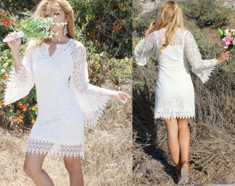 Short white boho dress worn by bride dancing
