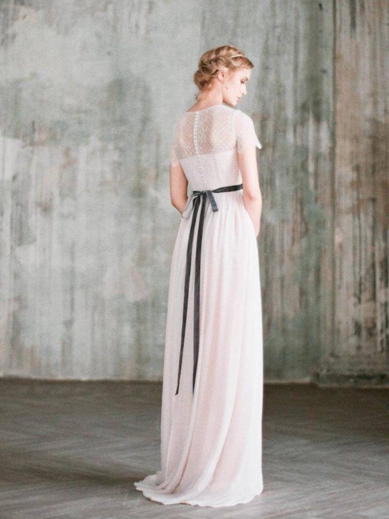 Bride with short-sleeved wedding dress